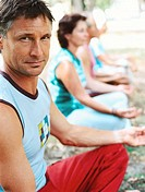 side profile close-up of an elderly man sitting cross legged in a meditative pose