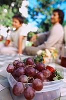 Close-up of a box of grapes at a family picnic