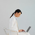 Side view of a businesswoman using a laptop