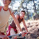 side profile close-up of two young men on mountain bikes in the wilderness
