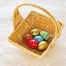 Elevated view of a basket containing multi-colored Easter eggs