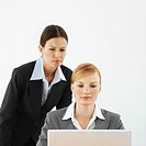 Front view of two businesswomen working on laptop