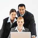 Front view of three business executives working on laptop