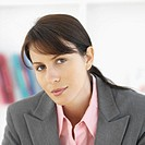 Close-up front view of businesswoman smiling