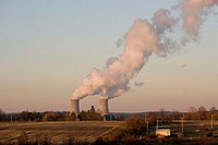 Collegeville, Pennsylvania. A nuclear power plant belches steam from its cooling towers.