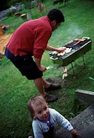 A little girl at a barbecue, Sweden