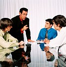 Group of young businessmen at a meeting