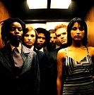Portrait of a group of young business executives standing in an elevator