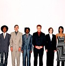 Front view portrait of a group of young business executives standing in a row
