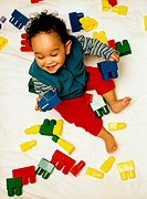 Elevated view of a baby (12-18 months) playing with building blocks