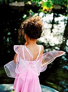 Rear view of a young girl dressed as a fairy (4-6)