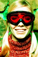 Close-up of a young woman wearing bomber goggles (toned)