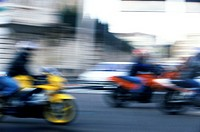 Motorbikes passing on a road (Blurred)