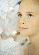 Girl next to christmas tree, portrait