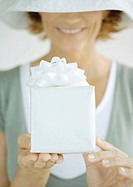 Woman holding out gift