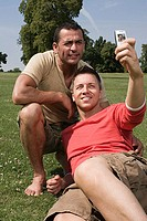 Gay couple photographing themselves