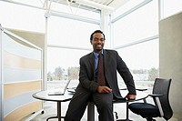 Businessman sitting on desk