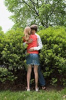 Teenage couple hugging in park