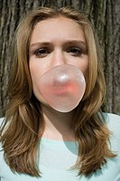 Girl eating bubble gum