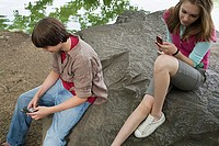 Teenagers using cellular telephones