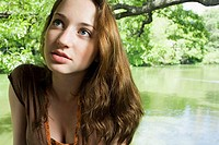 Teenage girl near a lake