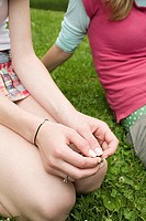 Teenage girls sitting in a park