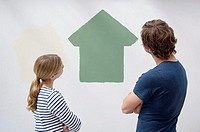 Couple looking at a painted house