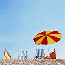 Deckchairs and parasol on the beach