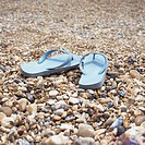 Flip flops on a shingle beach
