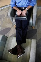 Office worker on chairs with laptop