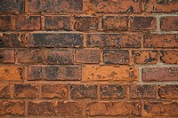 Front view of a bricked wall.