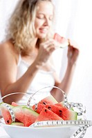 One Woman and a fresh bowl of watermelon with massband