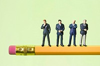 Miniature Businessmen on Pencil