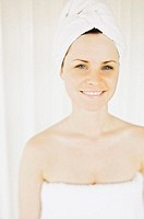 Smiling Woman in Bath Towels