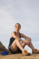 Seated Female Rock Climber