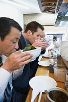 Businessmen eating