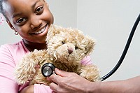 Girl and teddy with stethoscope