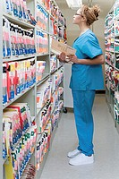 Hospital orderly in archives (thumbnail)