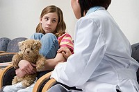 Doctor comforting nervous girl