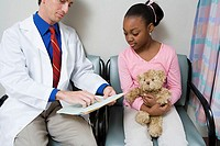 Doctor talking to girl