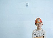 Boy wearing fireman's hat