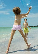 Children playing ball on the beach