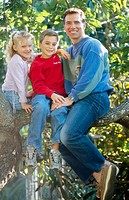 father and kids in a tree