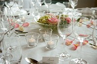 Table setting with lit candles