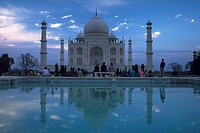 Taj Mahal and blue sky reflected in pool, Agra, India.