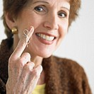 Senior Woman with String on Finger