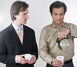 Businessman Taking Last Cup of Coffee