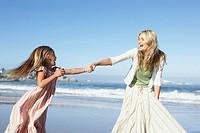 Woman and girl on beach