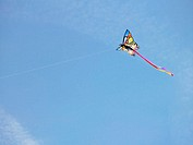 Kite flying aginst blue sky