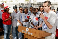 Clean up volunteers, Edison High School students, speaker, Mayor Manny Diaz, Hispanic. Little Haiti. Miami. Florida. USA.